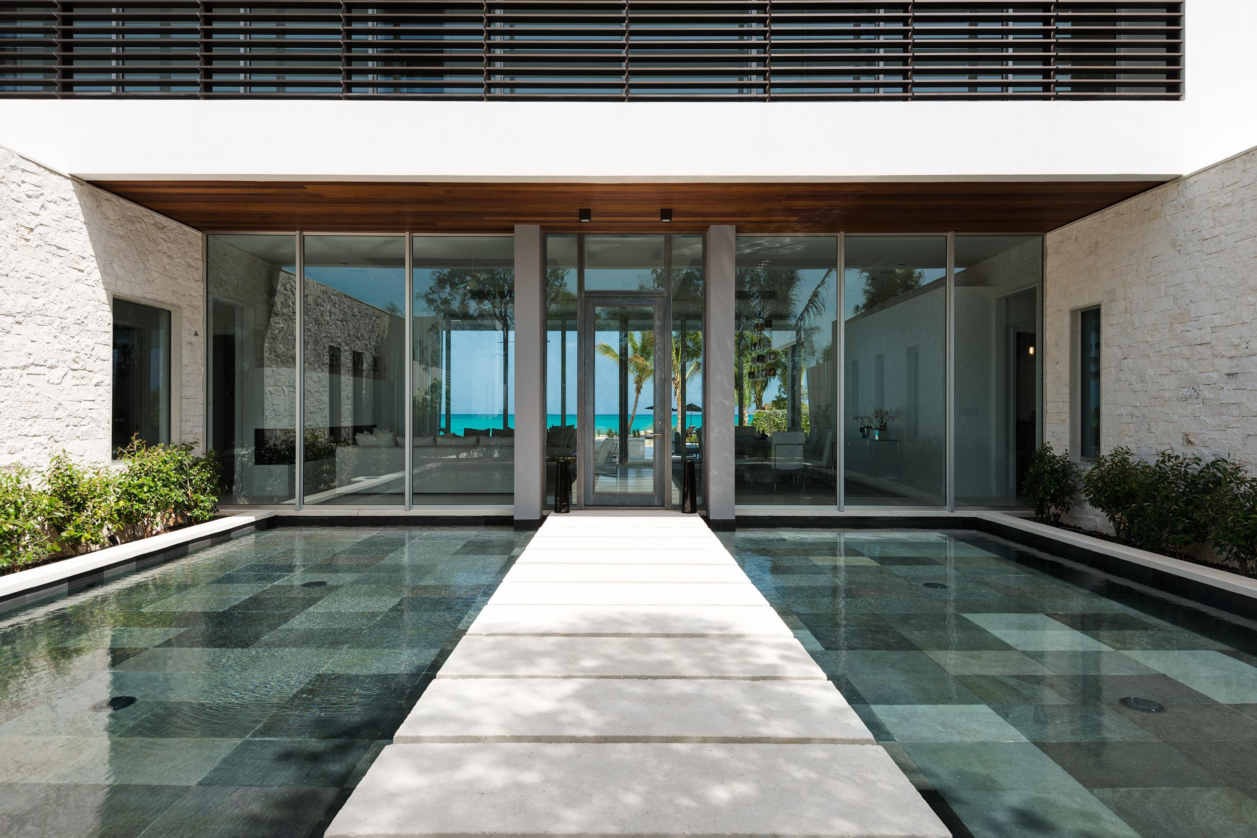 Villa Awa - view of the entrance and the reflecting pools