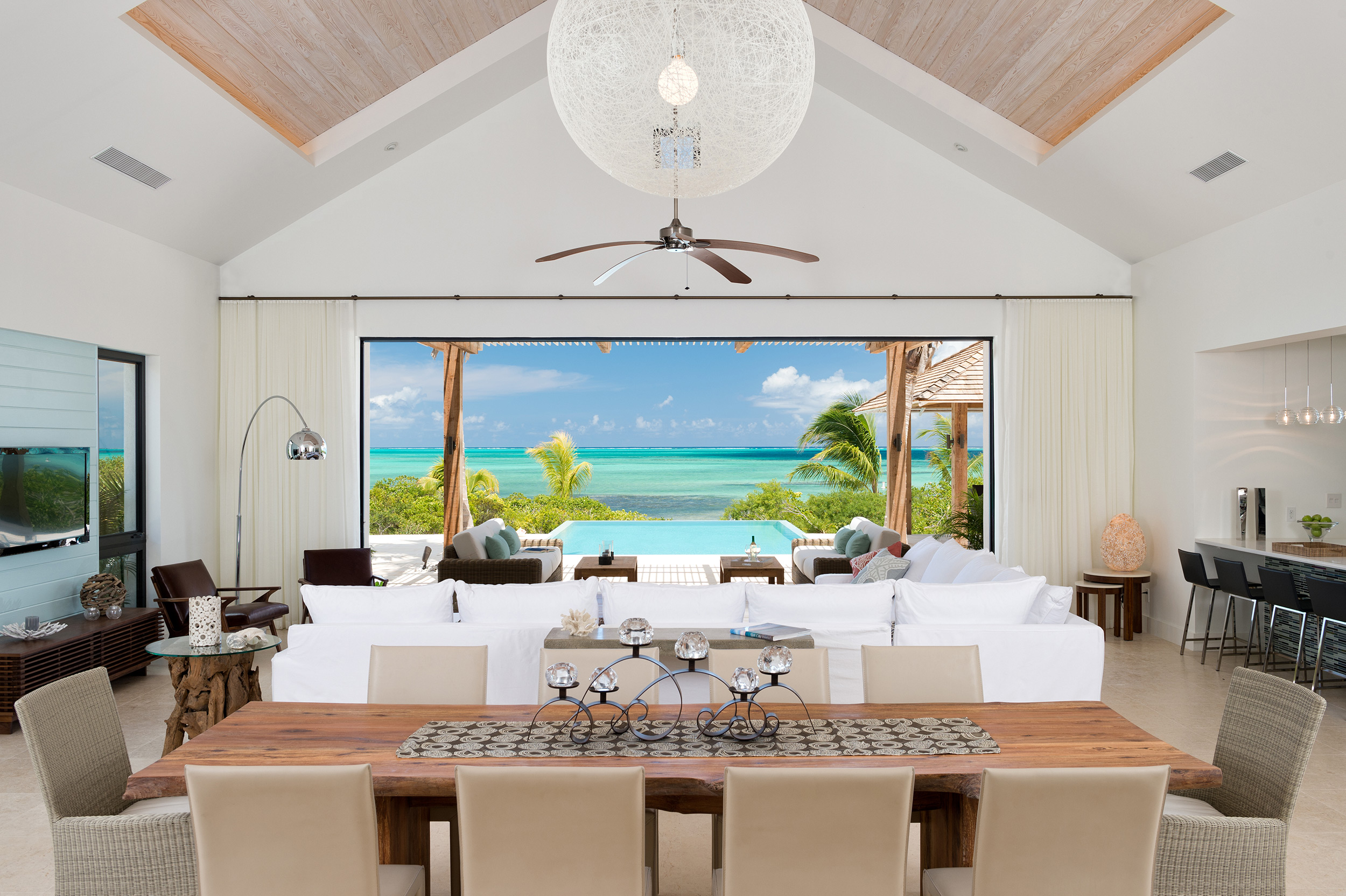 Castaway - view of the living and dining areas with the ocean beyond