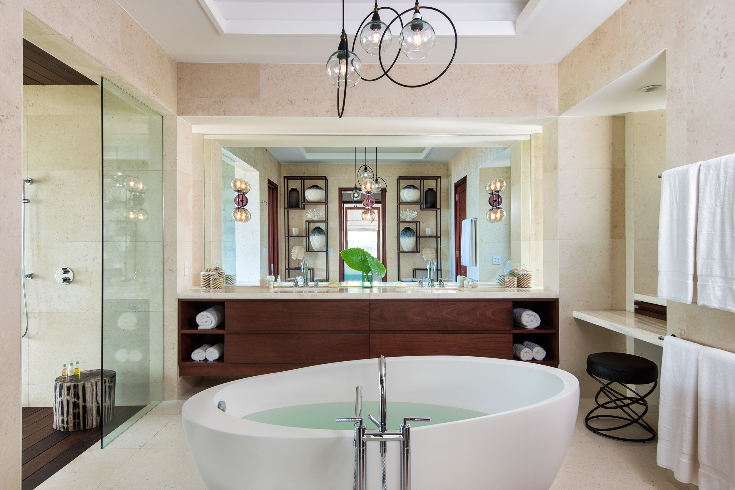 Hawksbill - view of one of the bathrooms, showing the vanity, mirror and bath tub