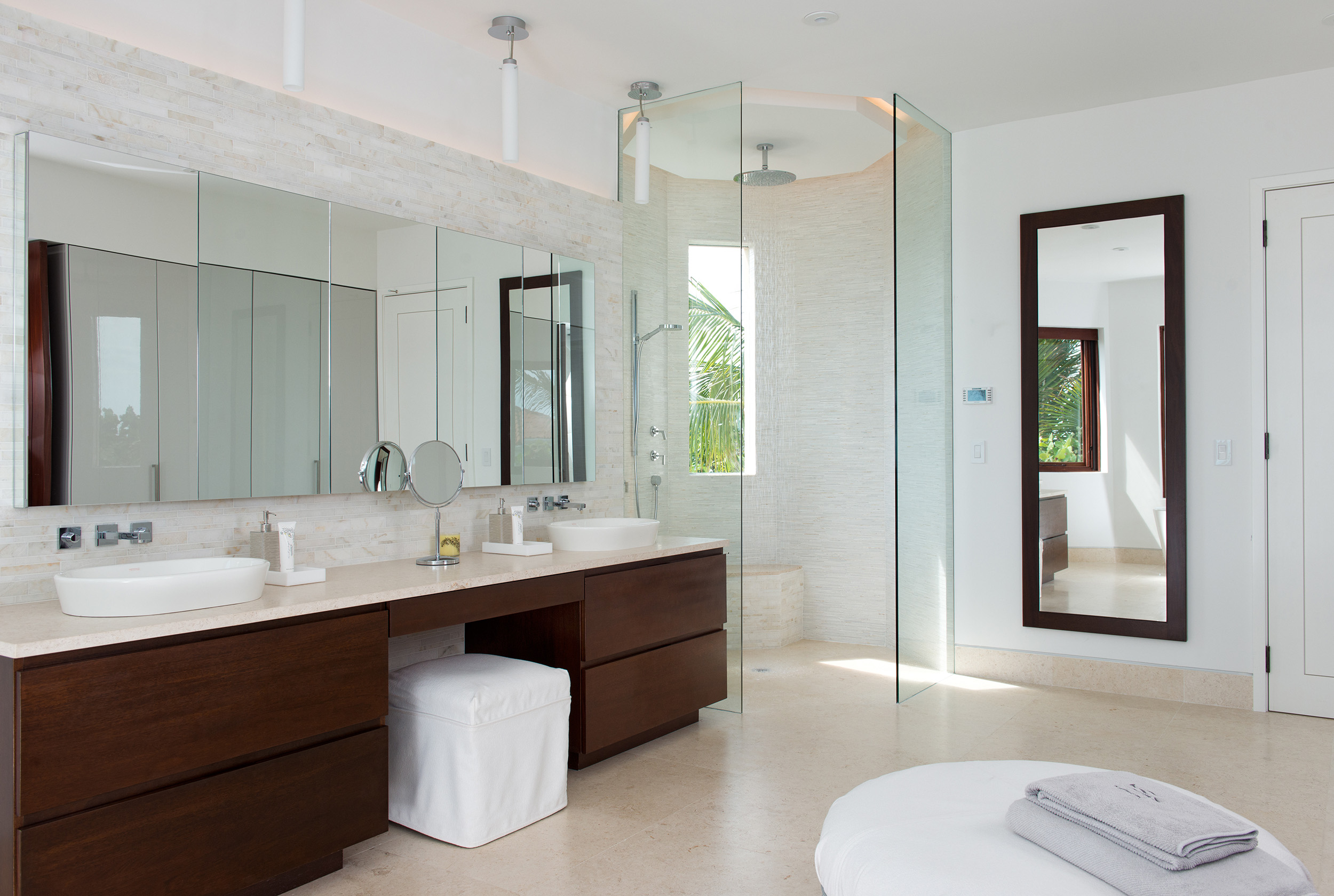 La Dolce Vita - view of one of the bathrooms showing the vanity, mirrors and rainshower