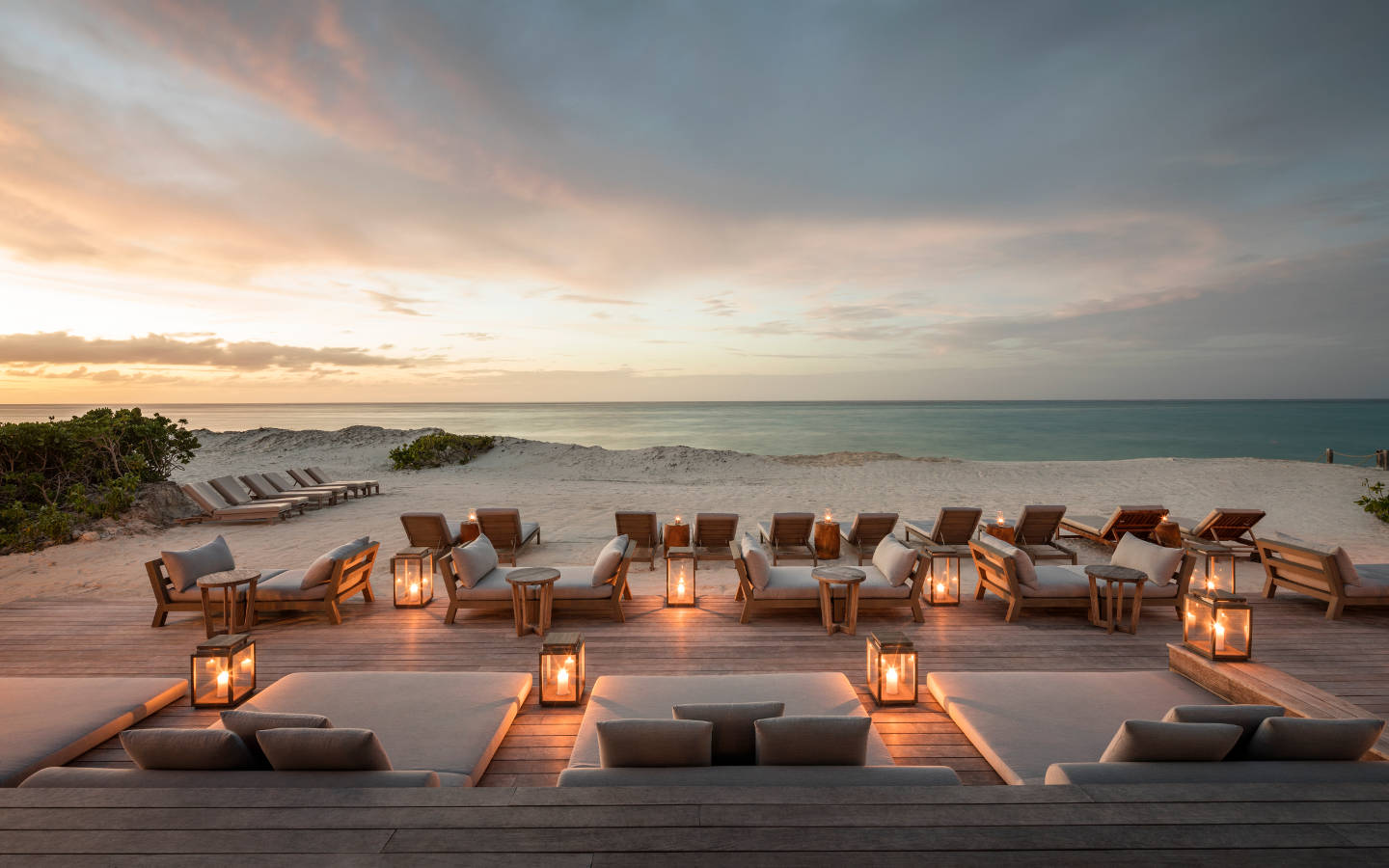 Parrot Cay - evening view of the beach and daybeds
