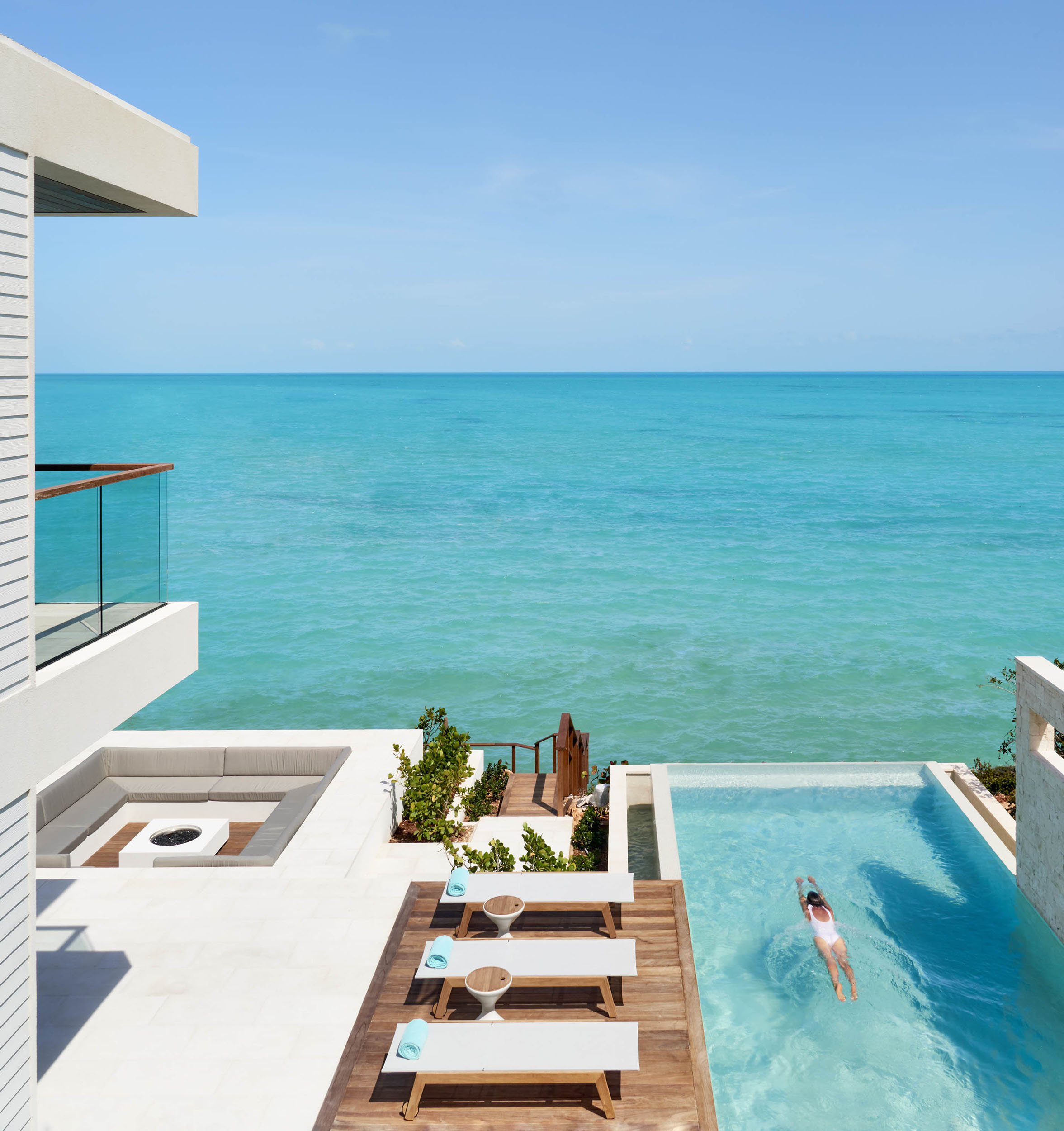 Wymara Villas - view from one of the upstair balconies, with fire pit, deck and infinity pool