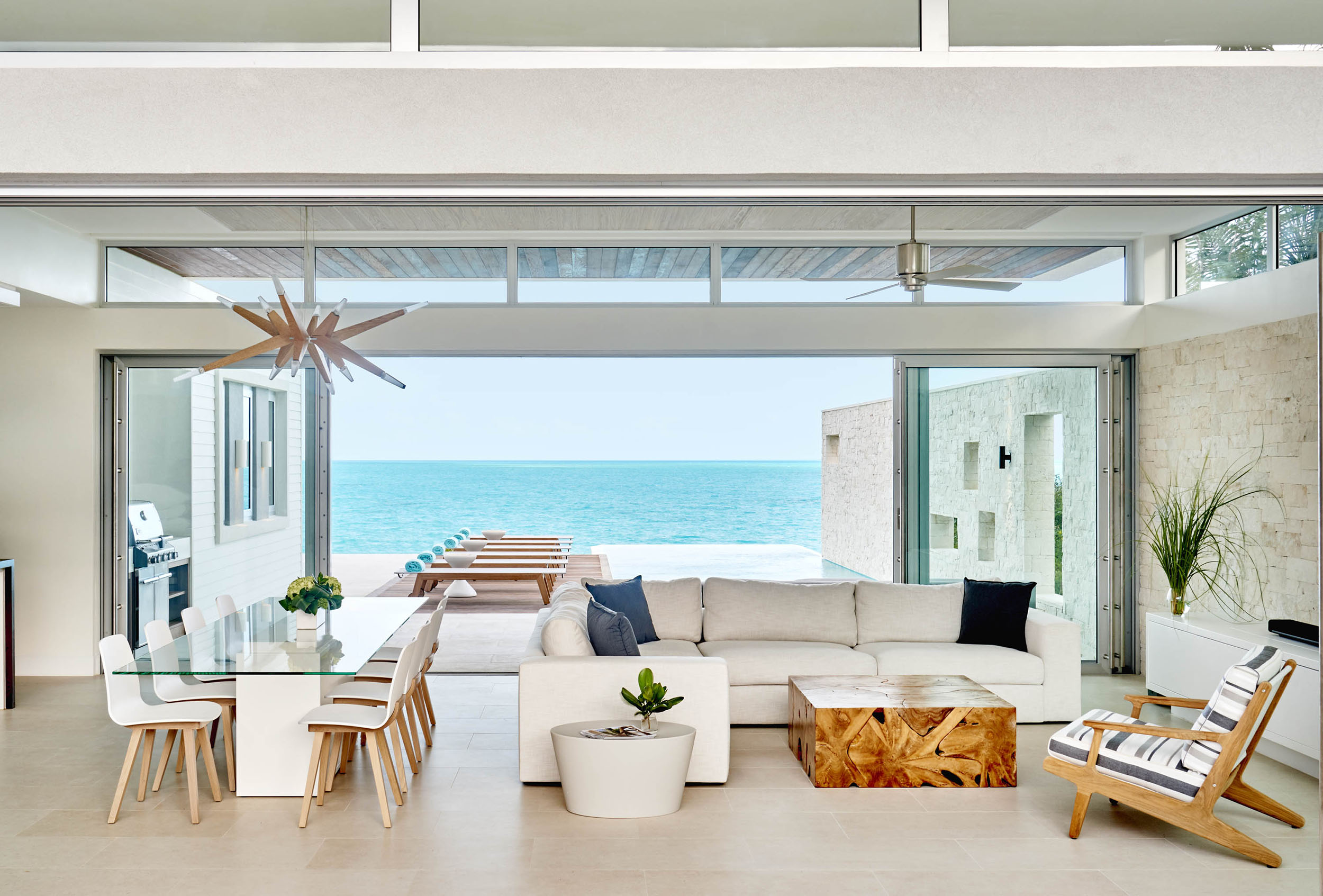 Wymara Villas - view of the living and dining area with pool and deck beyond