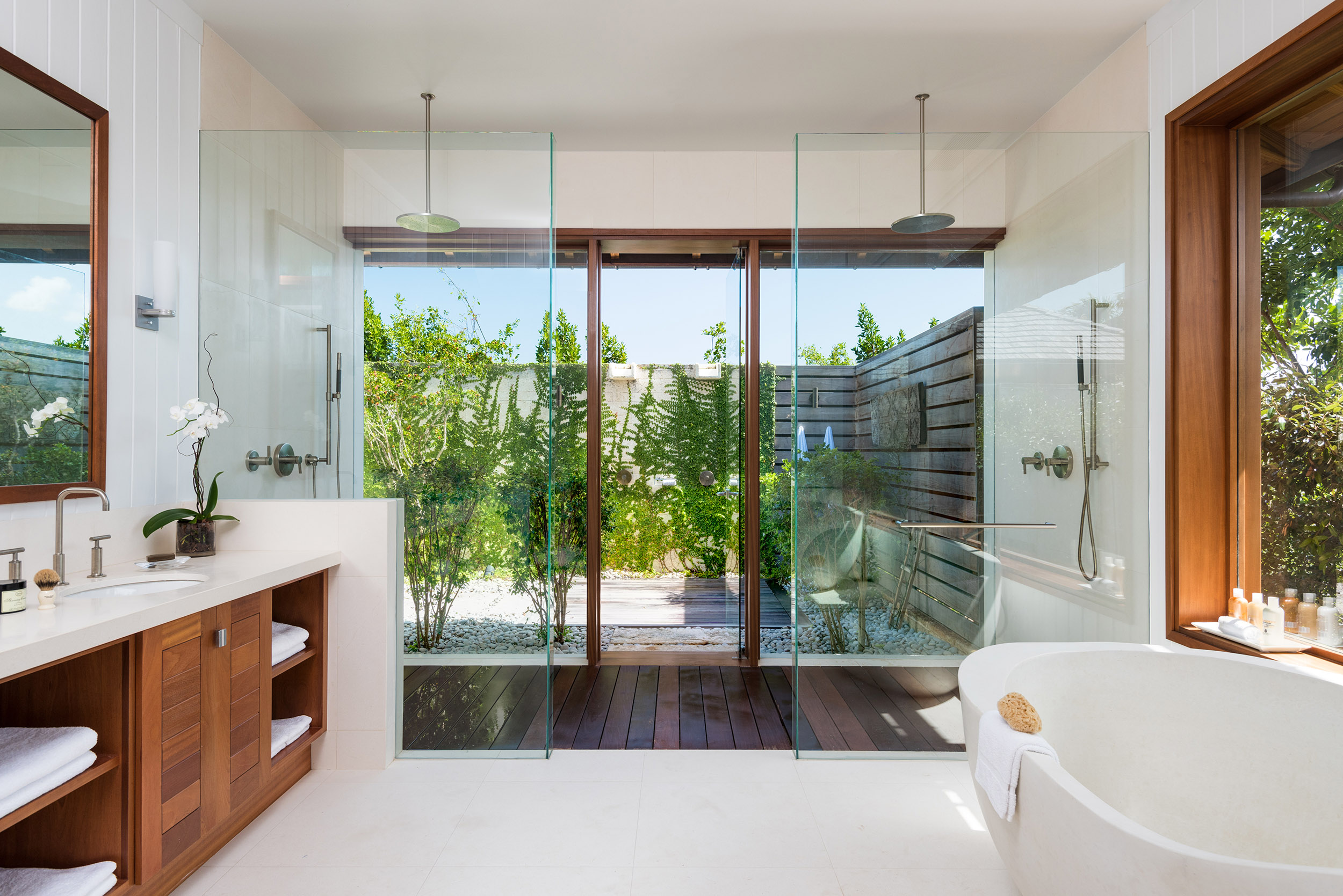 Serenity - view of one of the bathrooms with outdoor bathroom area beyond