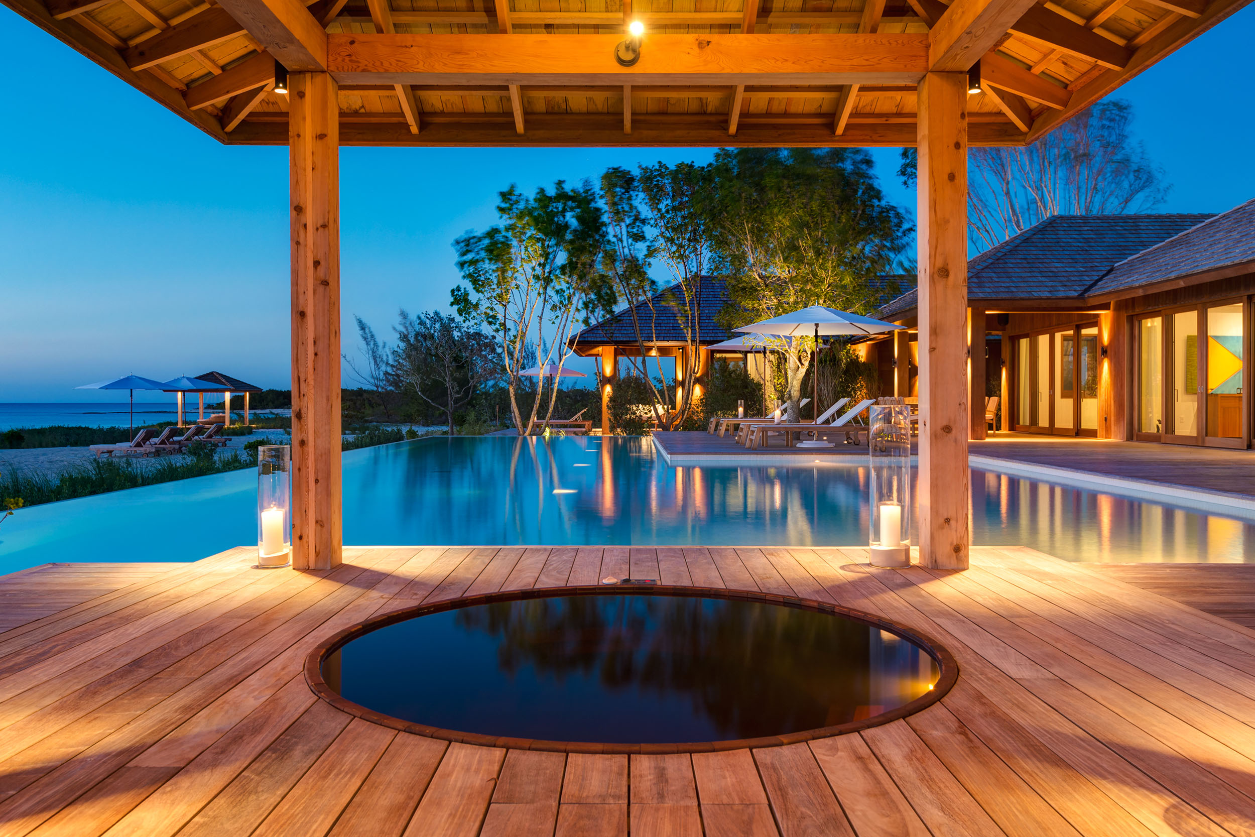 Serenity - evening view across the hot tub and pool