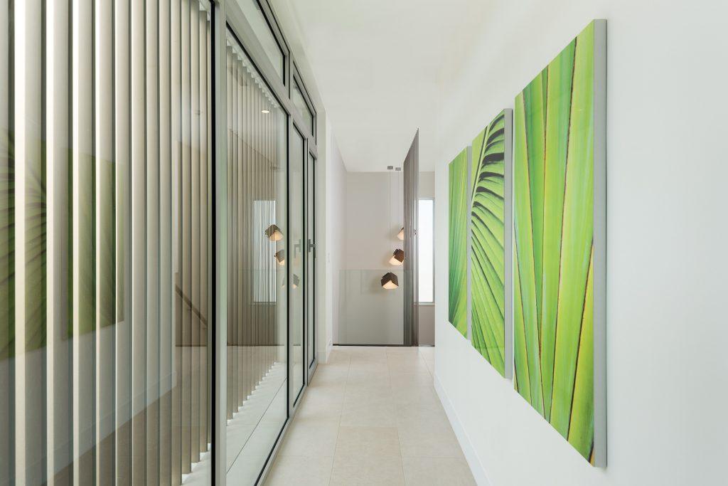 Wymara Villas - the upper hallway behind the brise soleil, with stairs beyond