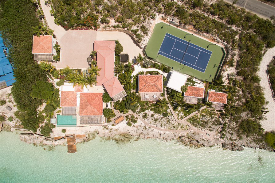 Dream Big Villa - aerial view showing the main house, bedroom pods and private tennis court