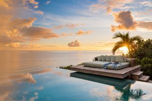 Dream Big Villa - sunset view across the pool