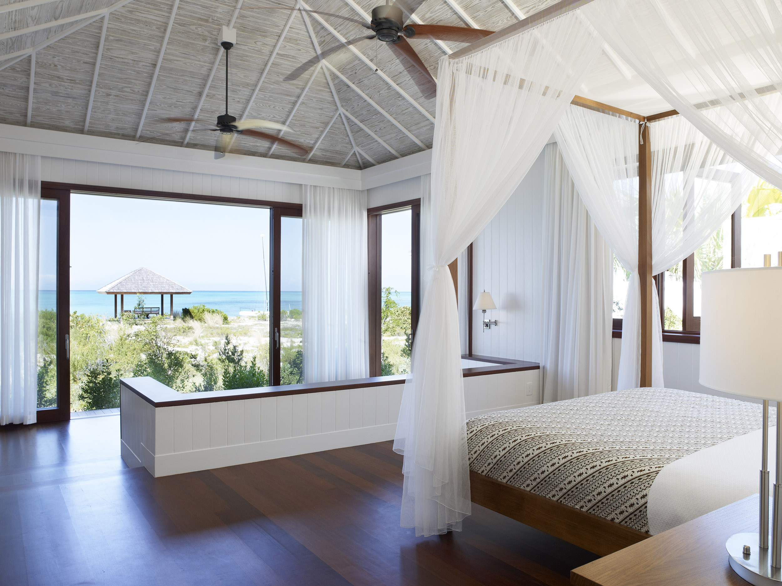 Tamarind - view of a bedroom, looking out to the beach