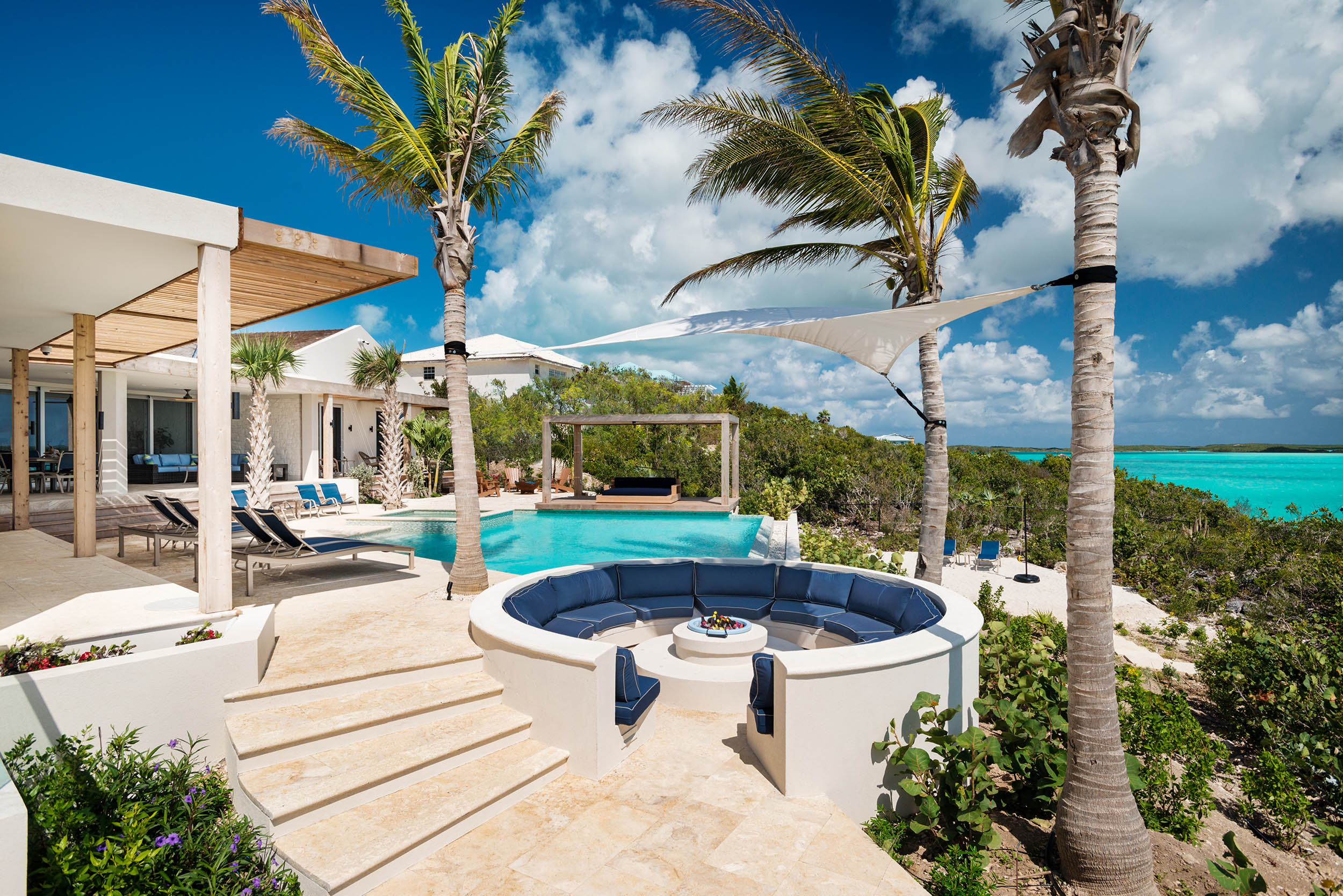 Villa Alinna - view of the fire pit, pool and cabana